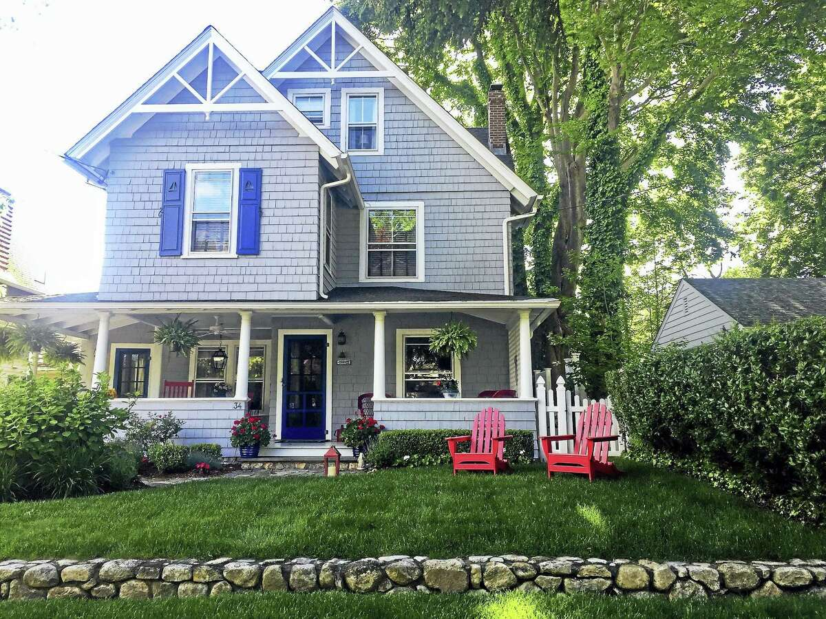 A boardinghouse built in 1890 for shipbuilders working at the wharves in Madison has been transformed into an all-American summer cottage, and is part of this year's Tour of Remarkable Homes, hosted by the Madison Historical Society.