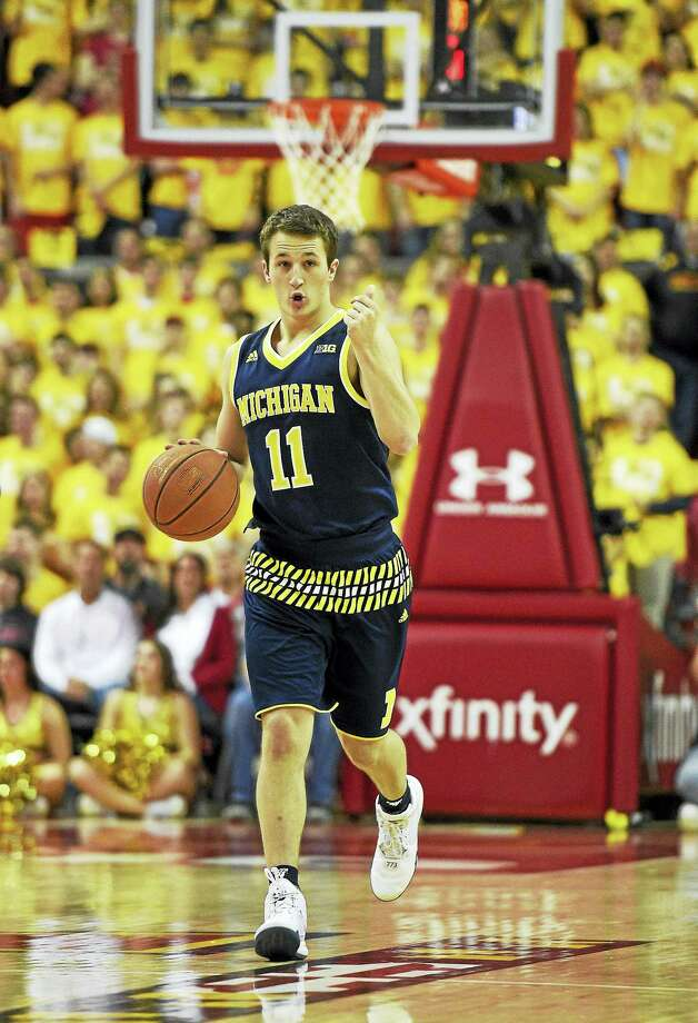 Former Michigan guard Andrew Dakich has backed out of a decision to play at Quinnipiac and instead will play at Ohio State. Photo: The Associated Press File Photo  / FR67404 AP