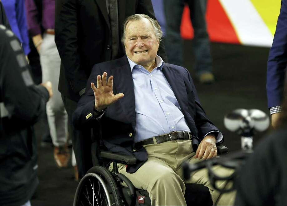 Former President George H. W. Bush waves as he arrives at NRG Stadium before the NCAA Final Four tournament college basketball semifinal game between Villanova and Oklahoma in Houston last April. Houston-area media are quoting former President George H.W. Bush's chief of staff as saying that Bush has been hospitalized in Houston. Photo: David J. Phillip — AP File Photo  / Copyright 2016 The Associated Press. All rights reserved.