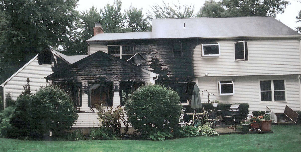 This July 2007 photo provided by police, made available Sept. 21, 2011 by the Connecticut Judicial Branch as evidence and presented in the Joshua Komisarjevsky trial in New Haven, Conn., shows a fire-damaged portion of the William Petit home in Cheshire, Conn., where his wife Jennifer Hawke-Petit and daughters Hayley and Michaela were killed during a home invasion July 23, 2007.
