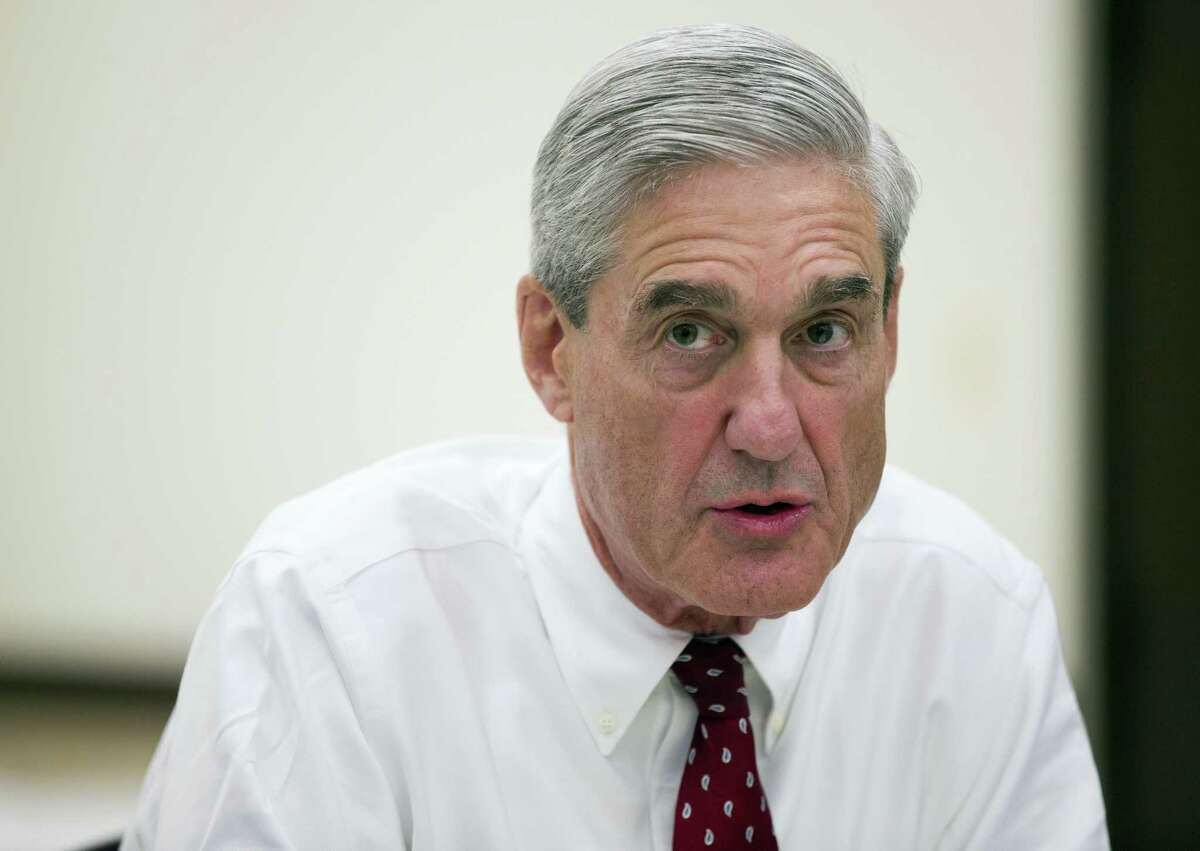 FILE - In this Aug. 21, 2013, file photo, then-FBI director Robert Mueller speaks during an interview at FBI headquarters in Washington. The Justice Department on May 17, 2017, appointed Mueller as a special counsel to oversee a federal investigation into potential coordination between Russia and the Trump campaign during the 2016 presidential election.