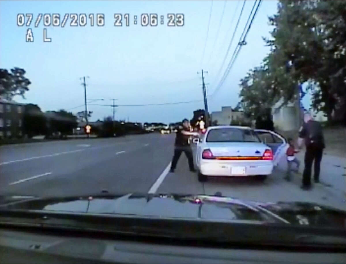 In this image made from July 6, 2016, video captured by a camera in the squad car of St. Anthony Police officer Jeronimo Yanez, the Minnesota police officer is shown after shooting into the vehicle at Philando Castile during a traffic stop in Falcon Heights, Minn., as the 4-year-old daughter of Castile's girlfriend, Diamond Reynolds, starts to get out of the car and is grabbed by an officer. The video was made public by the Minnesota Bureau of Criminal Apprehension and the Ramsey County Attorney's Office, Tuesday, June 20, 2017, just days after the officer was acquitted on all counts in the case.
