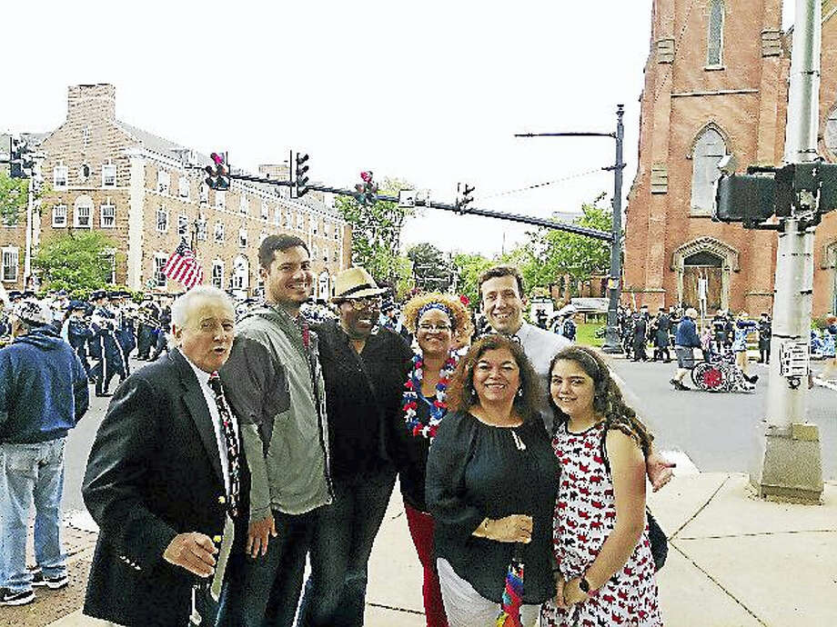 From left, Middletown Board of Education members Vinnie Loffredo, Chris Drake, Deborah Cain, Marilyn Dunkley Rios, state Rep. Matthew Lesser, Franca Biales and her daughter Gioia have fun at this year's Memorial Day parade downtown. Photo: Courtesy Franca Biales