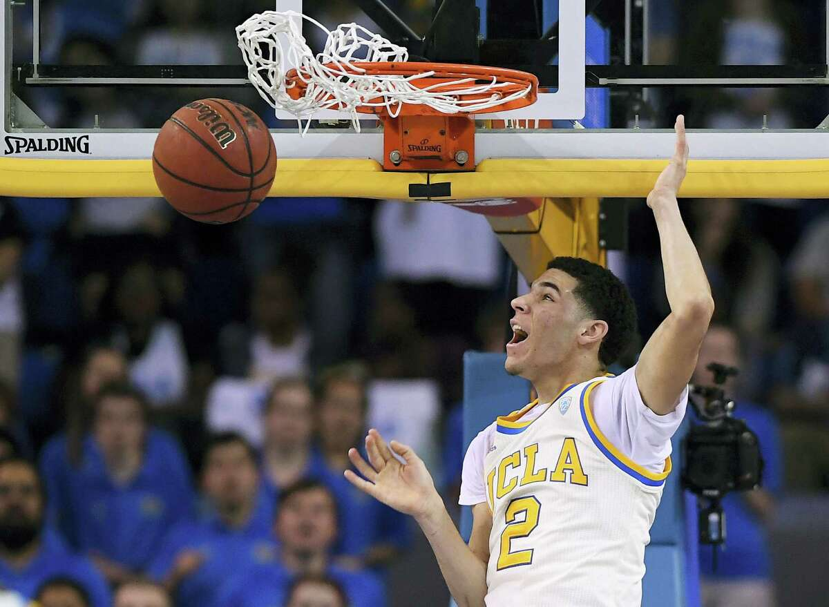 In this March 4, 2017 photo, UCLA guard Lonzo Ball dunks during the first half of an NCAA college basketball game against Washington State in Los Angeles. Ball is expected to be a top pick at the NBA Draft on Thursday, June 22.