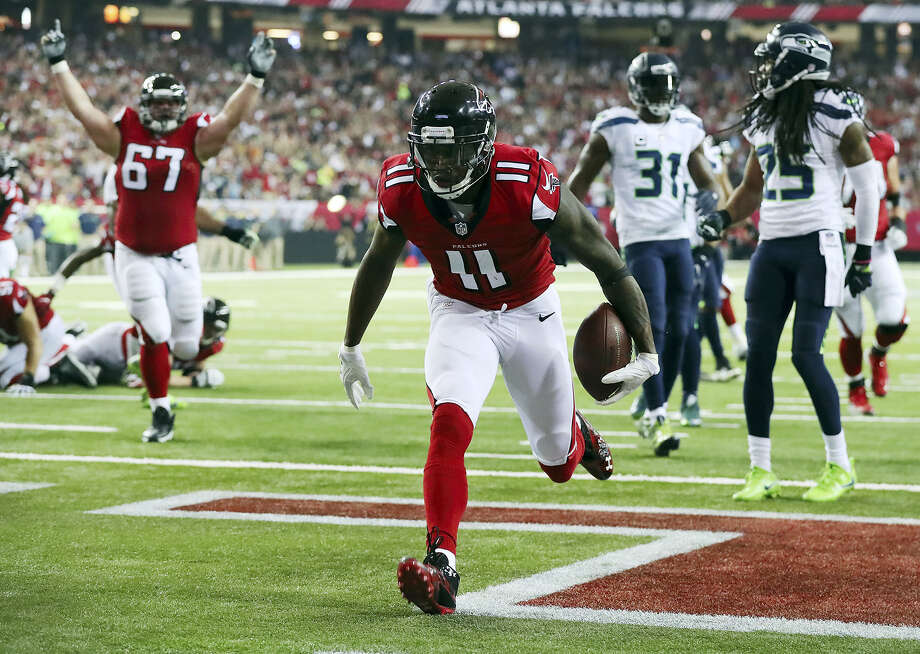 Atlanta Falcons wide receiver Julio Jones scores a touchdown against the Seattle Seahawks during the first quarter of an NFL football NFC divisional playoff game on Jan. 14, 2017 in Atlanta. Photo: Curtis Compton/Atlanta Journal-Constitution Via AP  / Atlanta Journal-Constitution