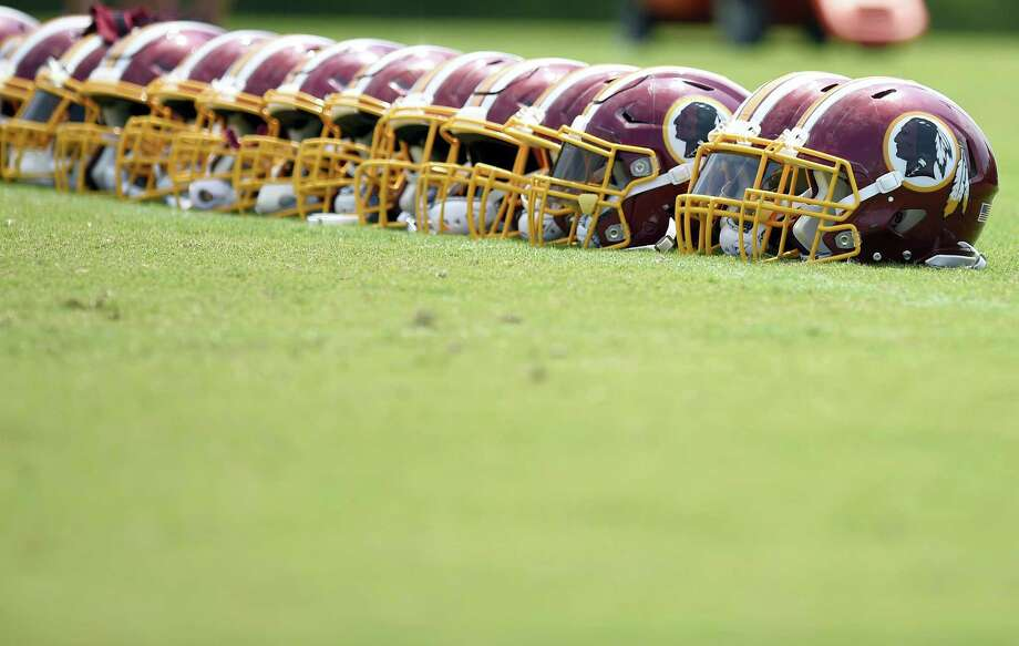 Washington Redskins football helmets are seen on the field during an NFL football team practice, Wednesday, June 14, 2017, in Ashburn, Va. Photo: AP Photo — Nick Wass  / FR67404 AP