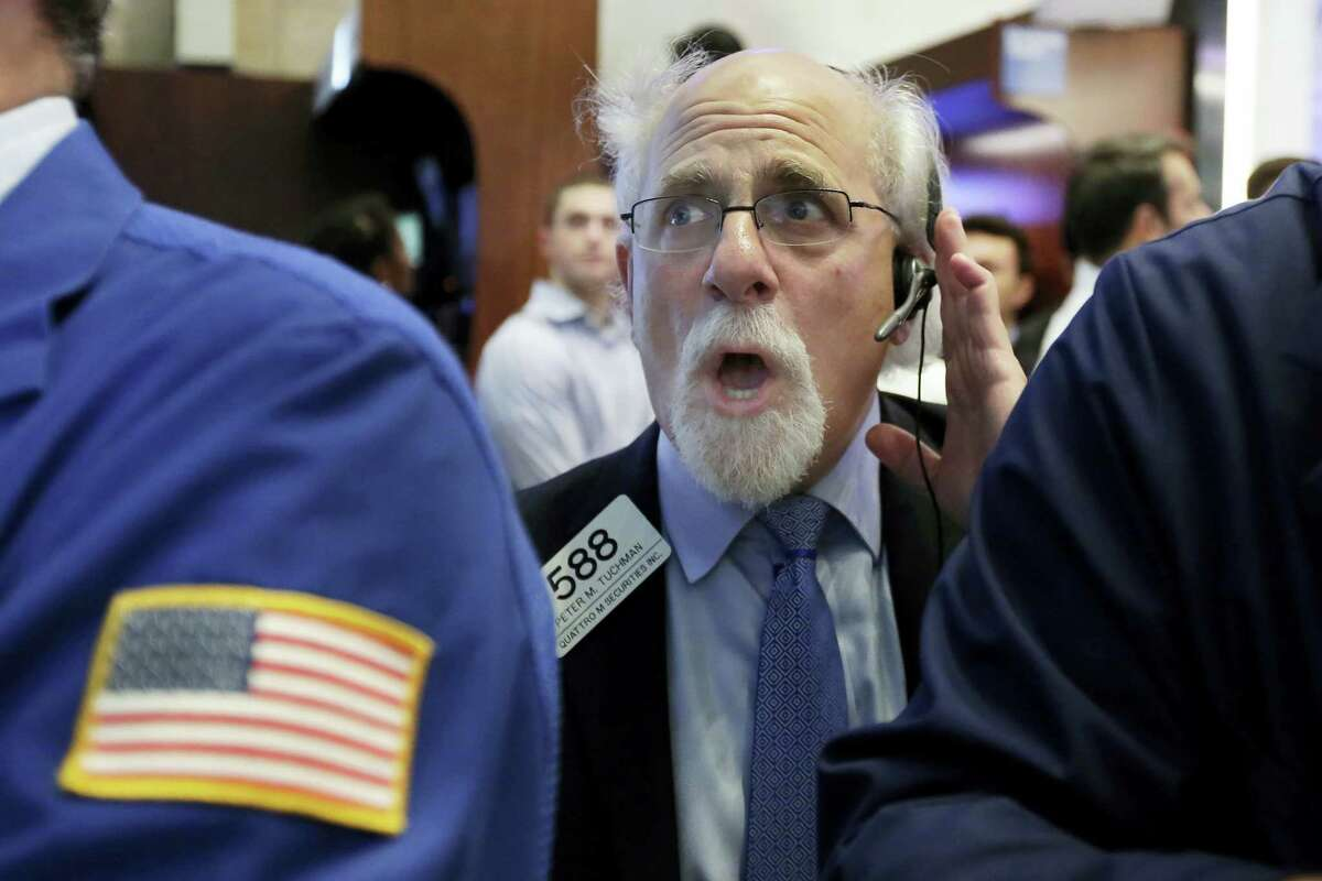 Trader Peter Tuchman works on the floor of the New York Stock Exchange Monday.