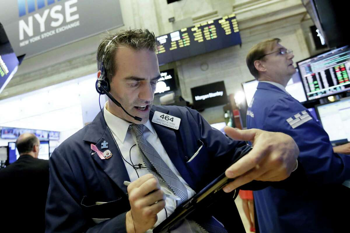 Trader Gregory Rowe works on the floor of the New York Stock Exchange Monday.