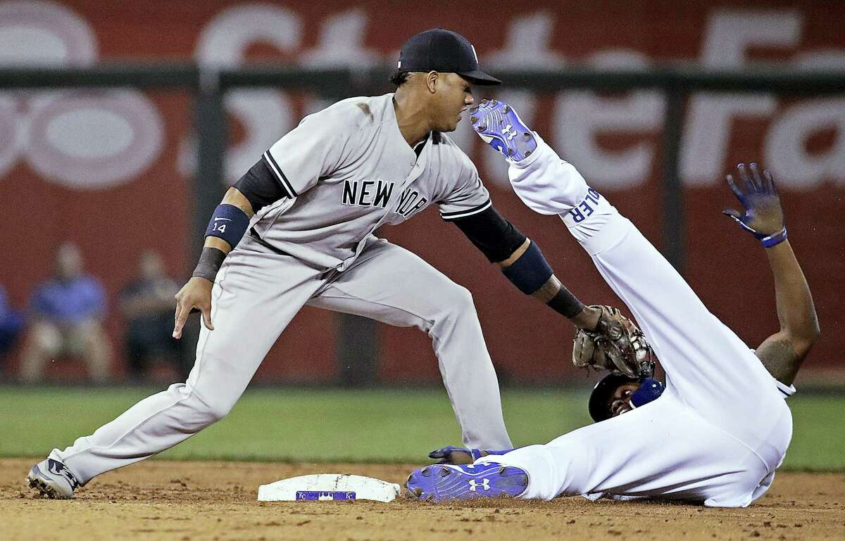 Kansas City Royals' Jorge Soler is tagged out at second by New York Yankees second baseman Starlin Castro after trying to stretch a single into a double during the fifth inning of the Yankees' win Tuesday at Kansas City, Mo.
