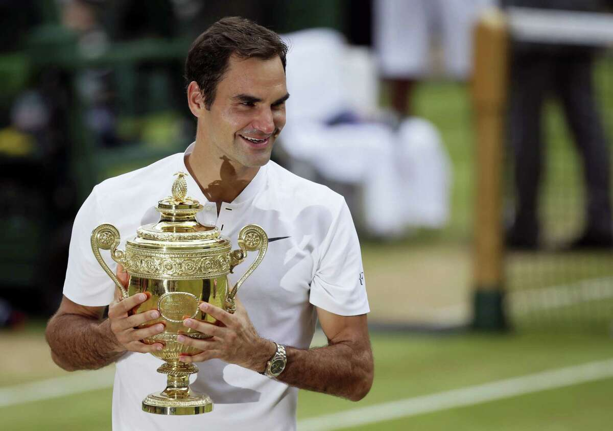 Roger Federer holds the trophy after defeating Croatia's Marin Cilic to win the men's singles final at Wimbledon on Sunday.