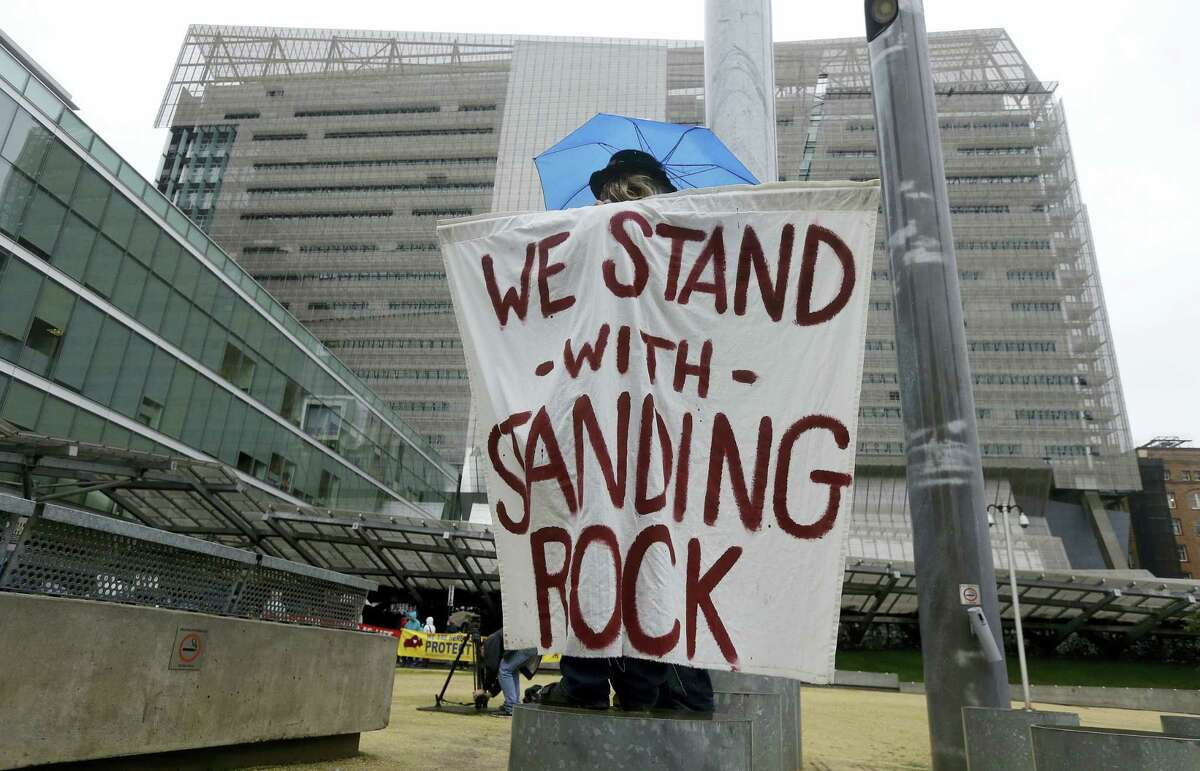 Opponents of the Dakota Access oilpipeline protest at the San Francisco Federal Building in San Francisco, Feb. 8. Opponents of the Dakota Access oilpipeline called for protests around the world Wednesday as the Army prepared to green-light the final stage of the $3.8 billion project's construction.