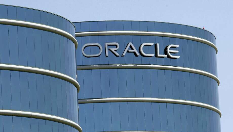 This file photo shows Oracle headquarters in Redwood City. Photo: Paul Sakuma — The Associated Press File  / AP2012