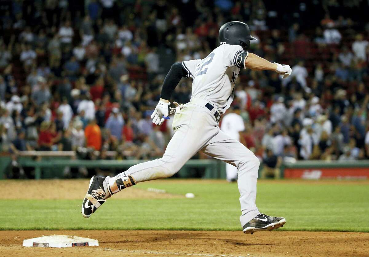 New York Yankees' Jacoby Ellsbury rounds first base on his double during the 16th inning of a baseball game against the Boston Red Sox in Boston on July 15, 2017. The Yankees won 4-1.
