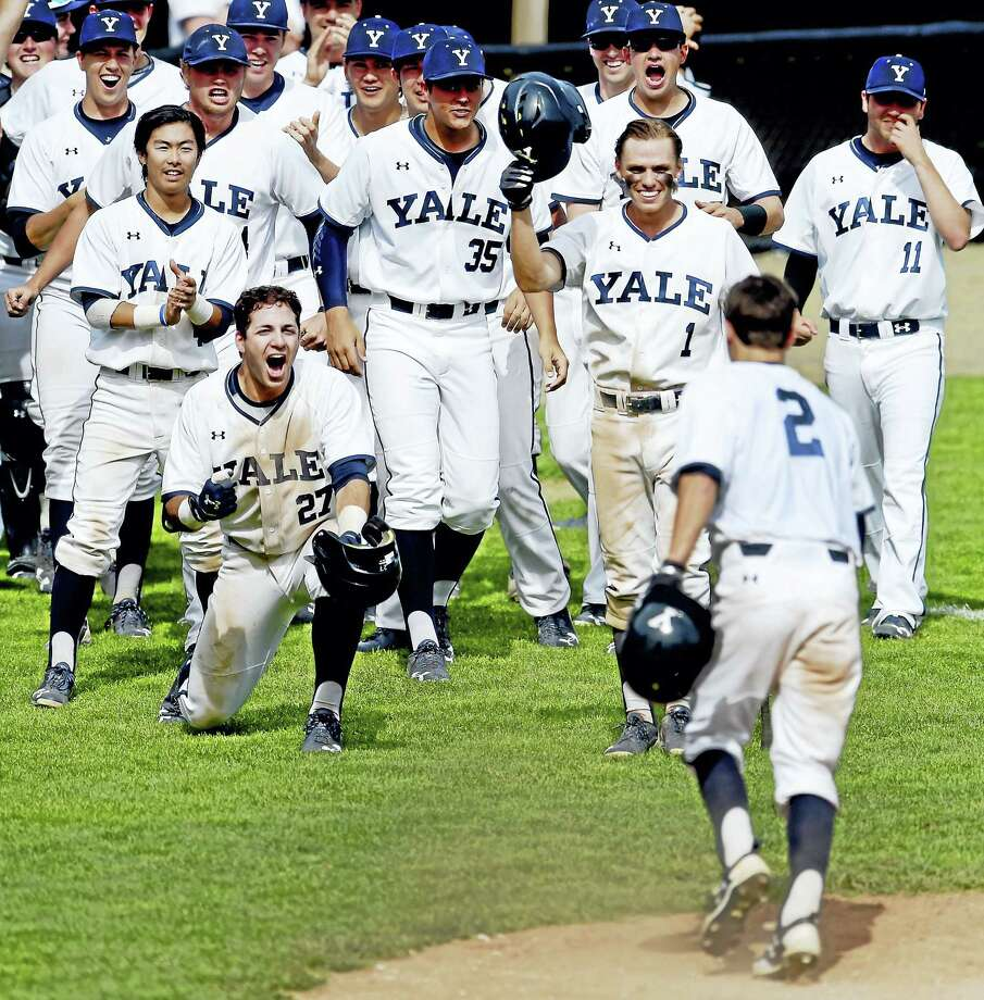 Yale's Tim DeGraw, right, foreground, is congratulated by teammates after hitting a three-run home run during the third-inning of game two of the Ivy League Baseball Championship Series against Penn at Yale Field Tuesday. Yale swept the series to win the league title and earn a bid to the NCAA tournament. Photo: Peter Hvizdak — New Haven Register  / ©2017 Peter Hvizdak