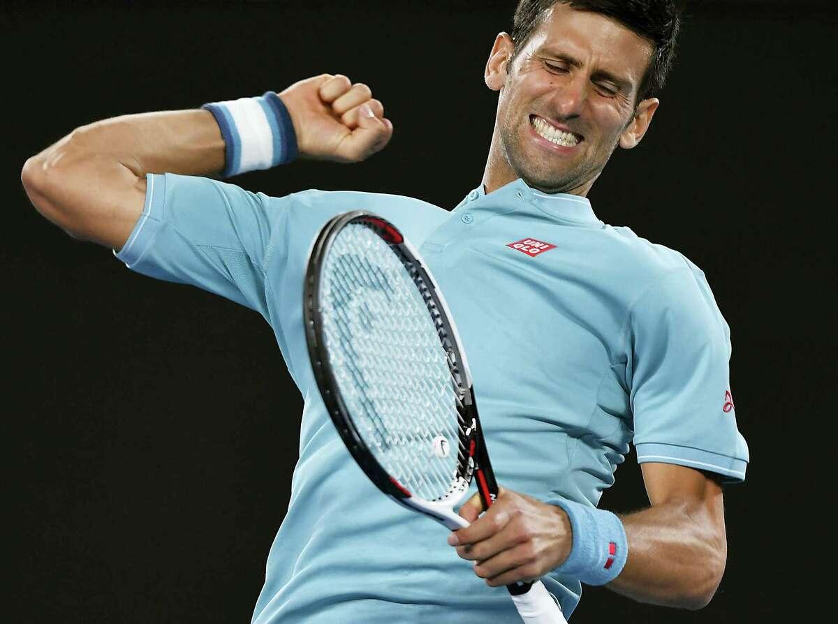 Serbia's Novak Djokovic celebrates after defeating Spain's Fernando Verdasco in their first round match at the Australian Open tennis championships in Melbourne, Australia on Jan. 17, 2017.