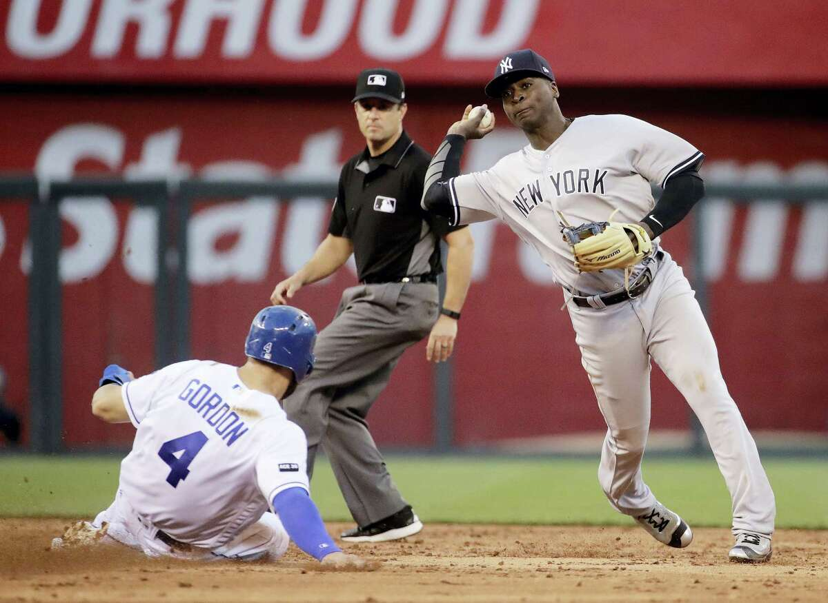 New York Yankees shortstop Didi Gregorius throws to first for the double play after forcing Alex Gordon out a second during the third inning Wednesday. The Yankees won 11-7.
