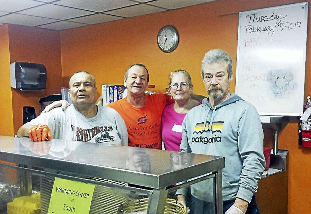 """Those enjoying a home-cooked meal at the St. Vincent dePaul soup kitchen Thursday afternoon on Main Street during the snowstorm. """"Lunch is on me,"""" joked one of the volunteer servers as he doled out a very tasty macaroni and cheese and a generous portion of barbecue ribs."""