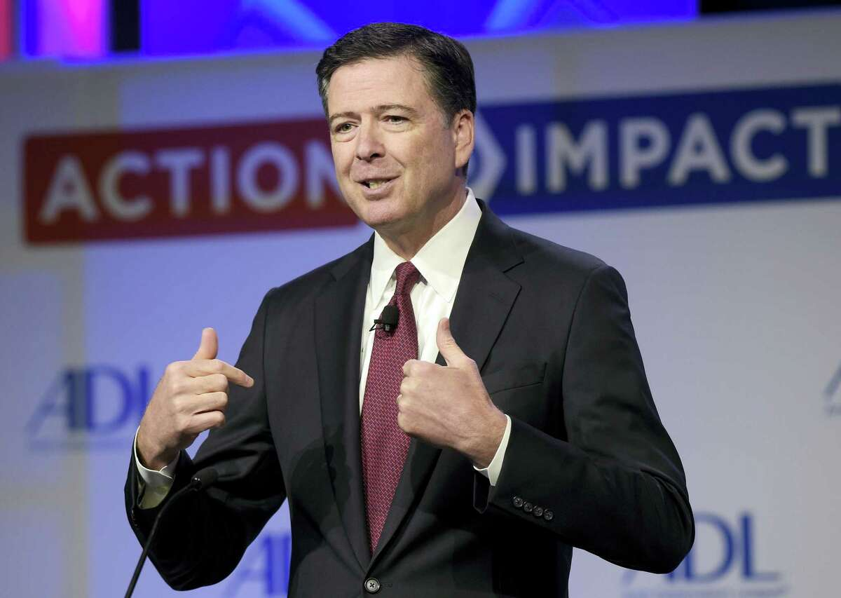 In this May 8, 201 photo, then-FBI Director James Comey speaks to the Anti-Defamation League National Leadership Summit in Washington. The White House is disputing a report that President Donald Trump asked Comey to shut down an investigation into ousted national security adviser Michael Flynn.