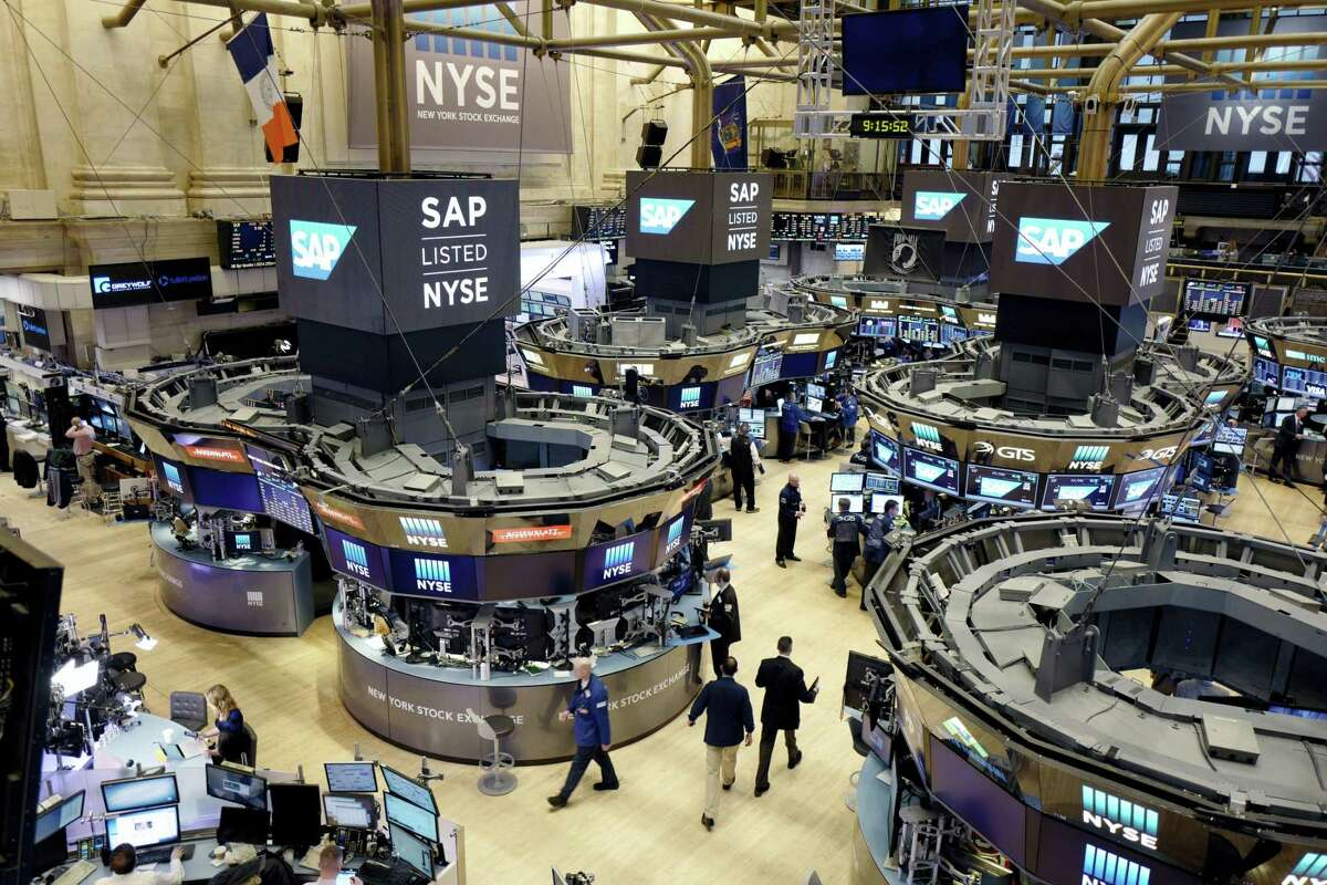 Traders work the floor at the New York Stock Exchange Thursday.
