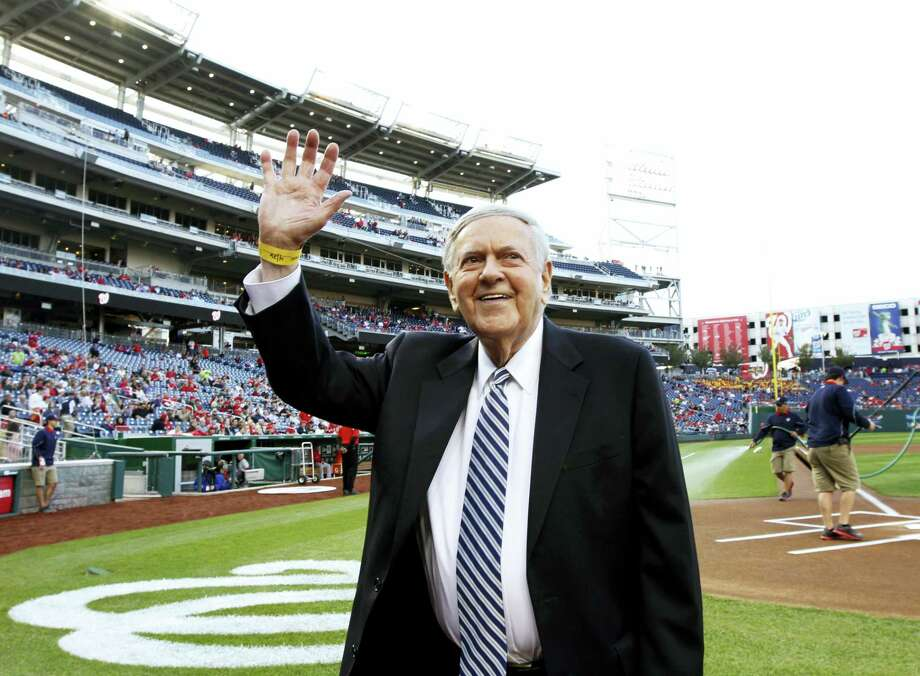 FILE - In this Friday, April 26, 2013 file photo, former Washington Senators broadcaster Bob Wolff waves to the crowd during a pre-game ceremony to honor him, before a baseball game between the Washington Nationals and the Cincinnati Reds at Nationals Park in Washington.  Bob Wolff, the only sportscaster to call play-by-play of championships in all four major North American professional team sports, has died, Saturday, July 15, 2017. He was 96. (AP Photo/Alex Brandon, File) Photo: AP / Copyright 2017 The Associated Press. All rights reserved.