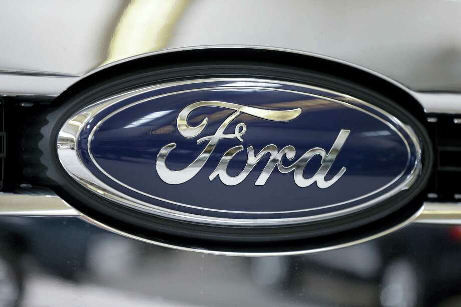 FILE - This file photo taken on Feb. 14, 2013 shows the Ford logo on the grill of a 2013 Ford F-350 truck on display at the Pittsburgh Auto Show in Pittsburgh. Ford reports quarterly financial results on Thursday, July 24, 2014. (AP Photo/Gene J. Puskar, File) Photo: AP / AP