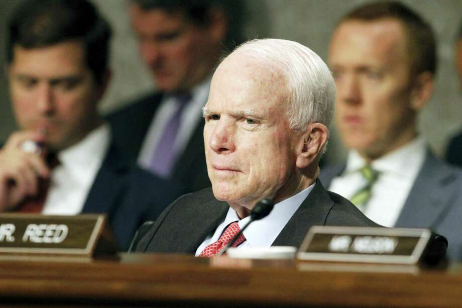 In this July 11, 2017 photo, Senate Armed Services Committee Chairman Sen. John McCain, R-Ariz. listens on Capitol Hill in Washington, during the committee's confirmation hearing for Nay Secretary nominee Richard Spencer. Surgeons in Phoenix said they removed a blood clot from above the left eye of McCain. Photo: AP Photo — Jacquelyn Martin, File  / Copyright 2017 The Associated Press. All rights reserved.