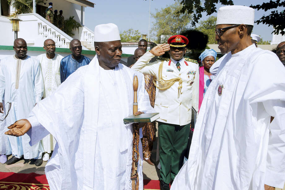 In this photo released by the Nigeria State House, Gambia President, Yahya Jammeh, left, speaks with Nigeria President Muhammadu Buhari, upon arrival in Banjul Gambia on Jan.13, 2017. Nigeria's president was leading a regional delegation to Gambia in a last-ditch attempt Friday to persuade its longtime leader to step down and allow his rival's inauguration next week, while fears grow that the impasse could turn violent. Photo: Bayo Omoboriowo — Nigeria State House Via AP  / Copyright 2017 The Associated Press. All rights reserved.