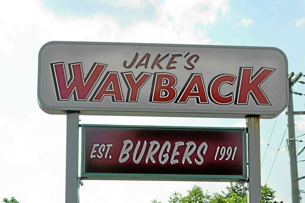 A sign for Jake's Wayback Burgers is seen in Torrington.