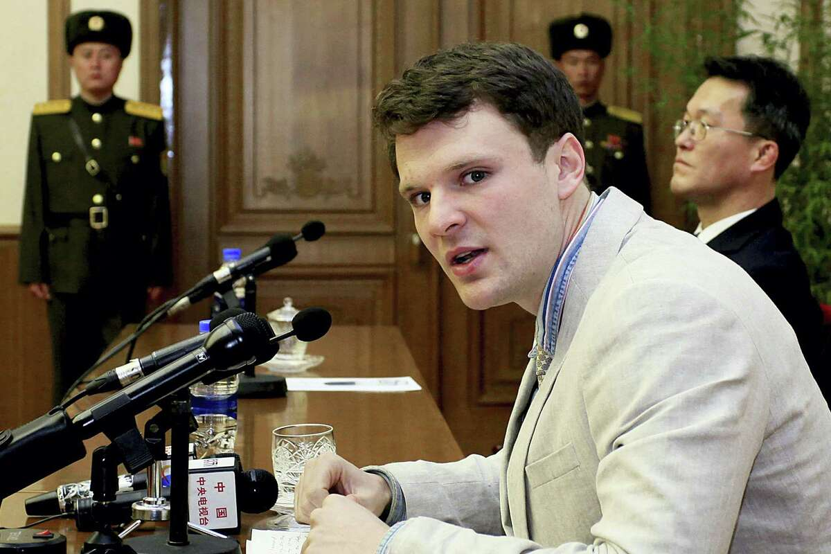 In this Feb. 29, 2016, file photo, American student Otto Warmbier speaks as he is presented to reporters in Pyongyang, North Korea. More than 15 months after he gave a staged confession in North Korea, he is with his Ohio family again. But whether he is even aware of that is uncertain.