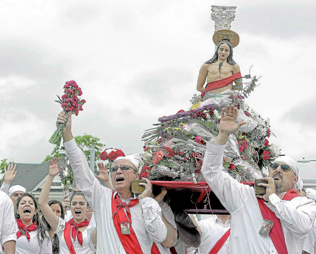"""The statue of St. Sebastian is carried through the streets of Middletown by """"I Nuri"""" during the annual Feast of St. Sebastian."""