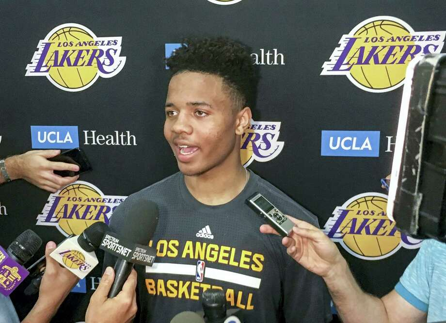 Markelle Fultz, center, speaks with reporters after his private workout with the Los Angeles Lakers at NBA basketball team's training complex on June 15, 2017 in El Segundo, Calif. The University of Washington guard could be the No. 1 pick in the NBA draft by the Boston Celtics, or he could be available to the Los Angeles Lakers with the second overall pick. Photo: AP Photo — Greg Beacham  / Copyright 2017 The Associated Press. All rights reserved.