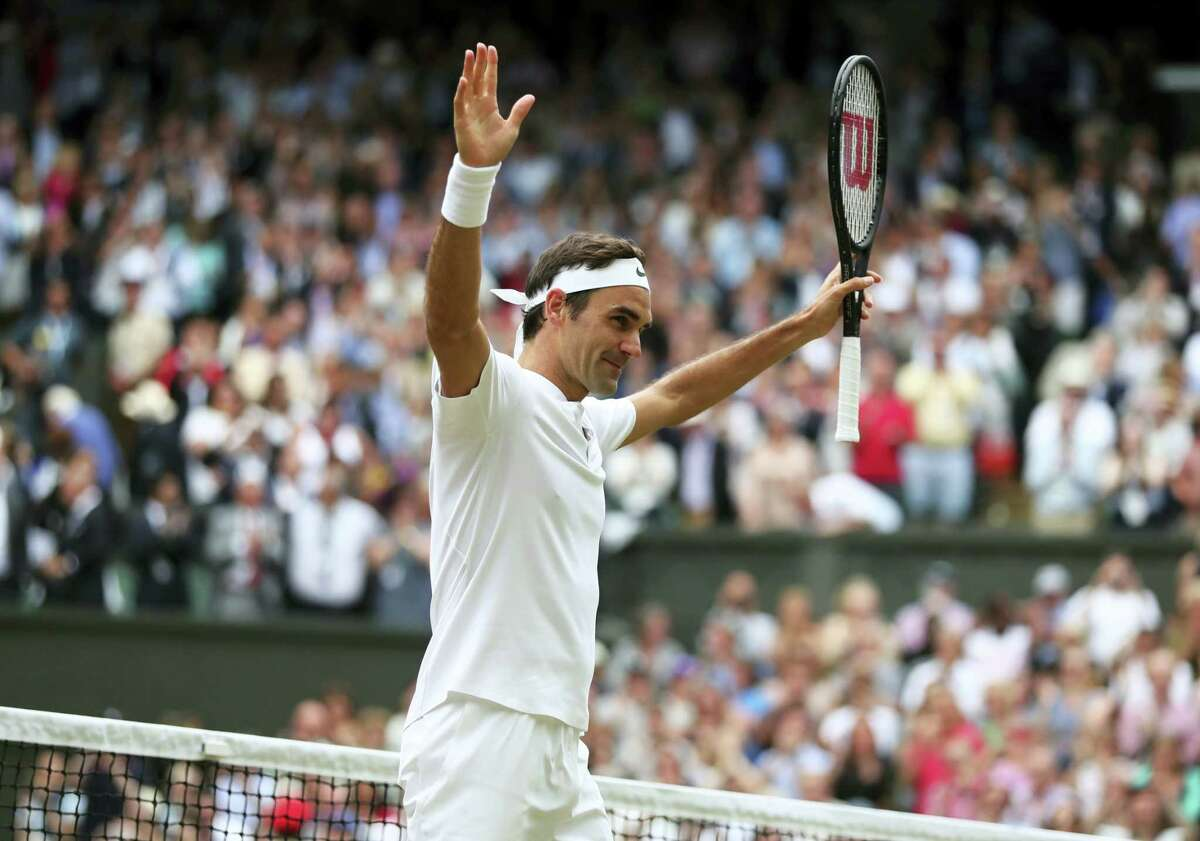 Roger Federer celebrates after beating Tomas Berdych in their men's singles semifinal match at Wimbledon on Friday.