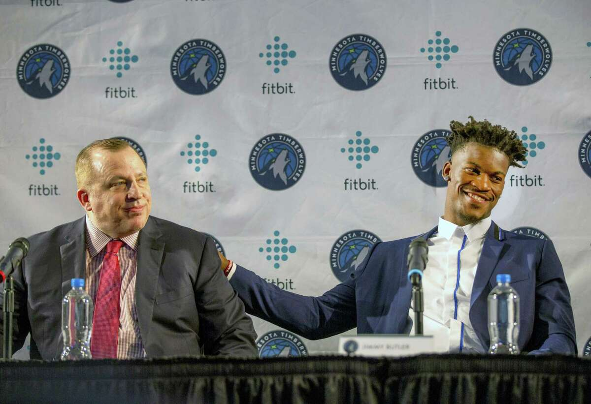 Minnesota Timberwolves new point guard Jimmy Butler, right, pats Timberwolves head coach Tom Thibodeau on the back during a press conference.