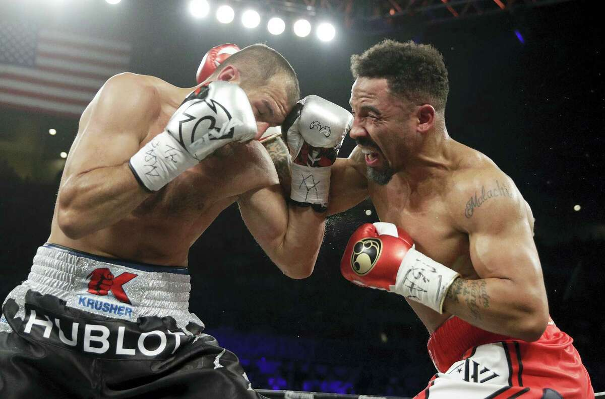 Andre Ward, right, fights Sergey Kovalev during a light heavyweight championship match late Saturday in Las Vegas.