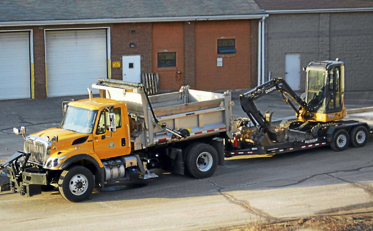 Middletown Public Works trucks, shown here at city yard on Washington Street, will begin their annual road work this spring.