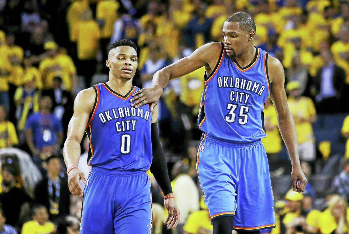Paul George Oklahoma City Thunder's Kevin Durant (35) pats teammate Russell Westbrook (0) on the shoulder as they take a lead over the Golden State Warriors during the second half in Game 1 of the NBA basketball Western Conference finals Monday, May 16, 2016, in Oakland, Calif. Oklahoma City won 108-102. (AP Photo/Marcio Jose Sanchez)