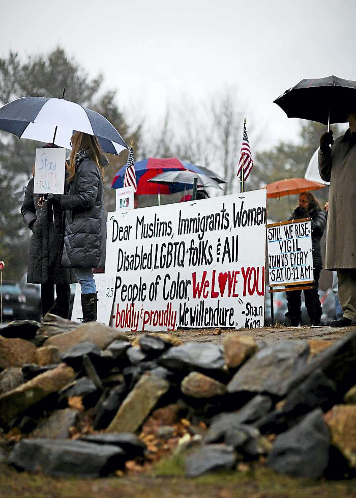"""A Still We Rise vigil, which has taken place weekly since November in East Haddam, is attended by a group of individuals each Saturday. """"The purpose is to keep social justice issues in the forefront of our community consciousness and to stand in solidarity with marginalized groups,"""" according to organizer Edwina Trentham."""