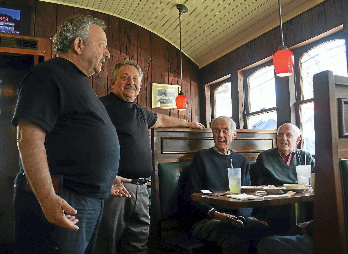 Twins Jim Carta and Joseph Carta, owners of the Cypress Grill on South Main Street, share a laugh with customers Bob Engstrom of Farmington, Vincent Marino of Durham, a longtime Middletown resident; and Bill Corchert of Canton. Since the attorneys retired from the same firm, they've been enjoying periodic meals at the restaurant with one another. Jim Carta said employees and customers sometimes have trouble telling the two apart — but he wears a tiny diamond earring in his left ear, which often helps distinguish the brothers.