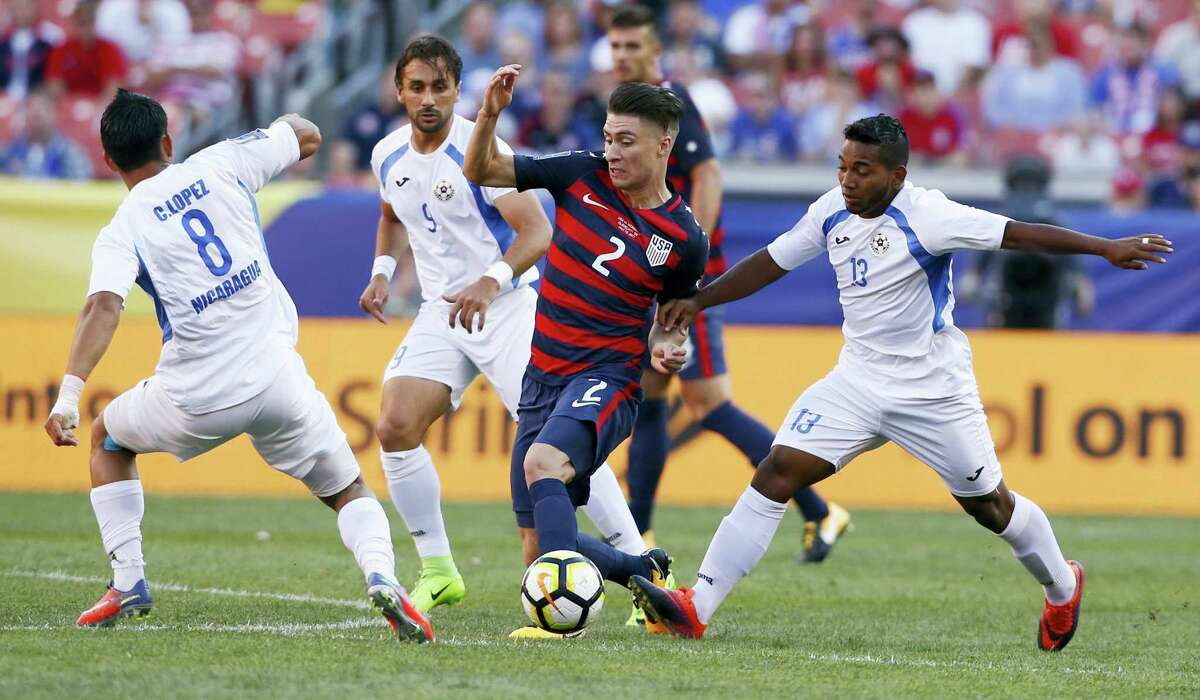 United States' Jorge Villafana (2) works through Nicaraguan defenders during their CONCACAF Gold Cup match in Cleveland on Saturday.