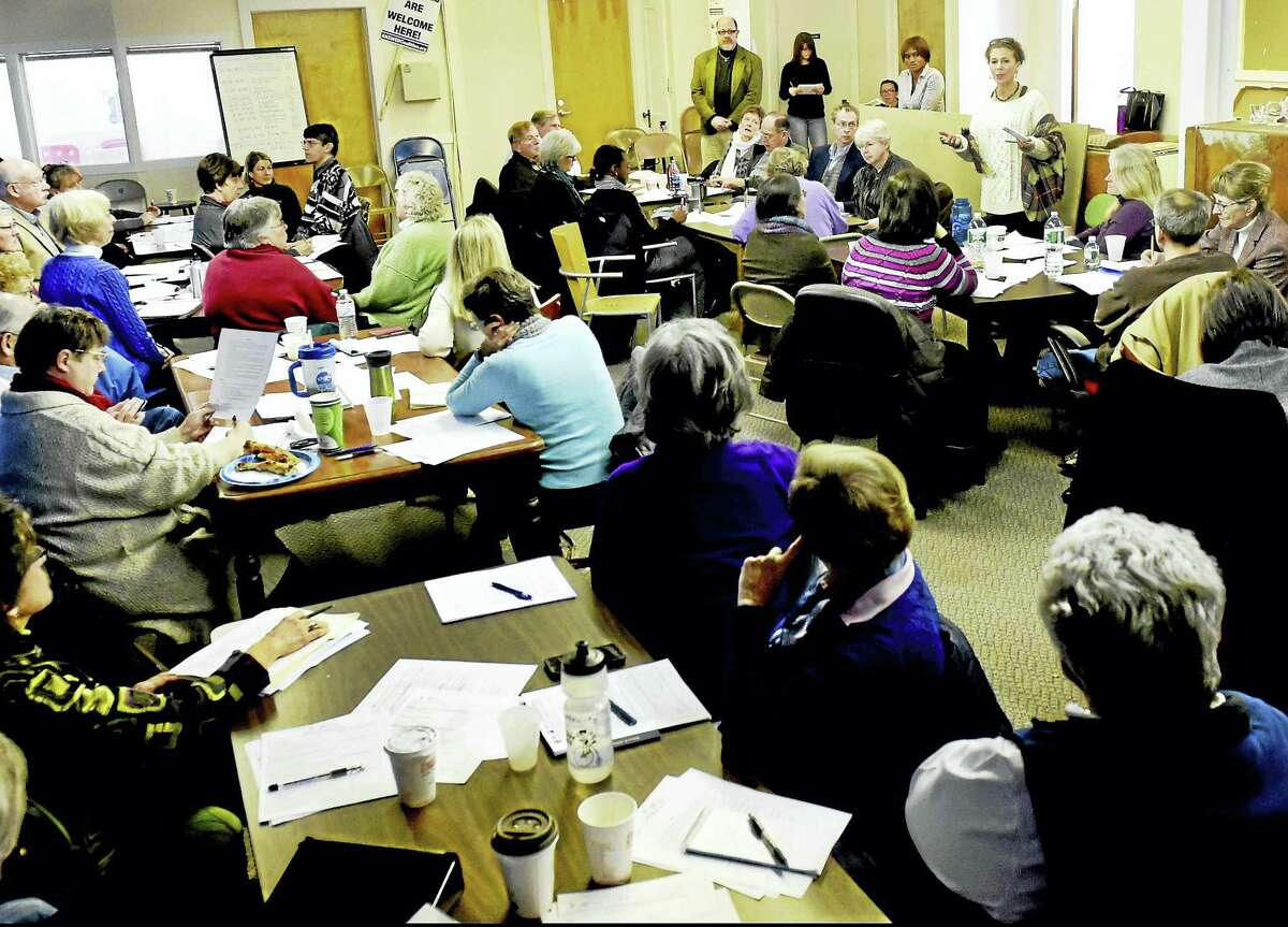 Leslie Koons, Health and Wellness Programming Coordinator for Integrated Refugee and Immigrant Services of New Haven at IRIS headquarters in New Haven Jan. 19, as she conducts a training session for area synagogues, churches and other groups that responded to the Syrian crisis by volunteering to resettle a refugee family through IRIS.