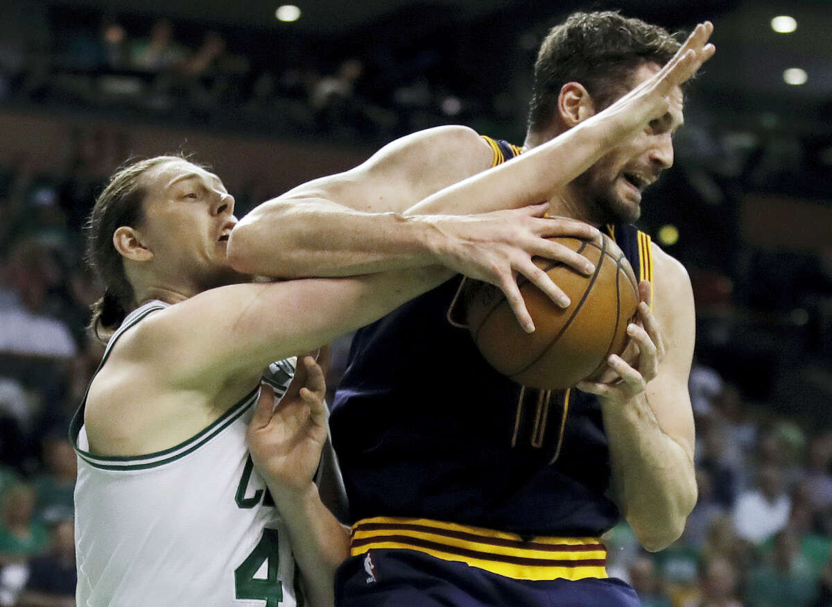 Boston Celtics center Kelly Olynyk, left, and Cleveland Cavaliers forward Kevin Love vie for a rebound during the first quarter of Game 1 of the NBA's Eastern Conference finals Wednesday. The Cavs won 117-104.