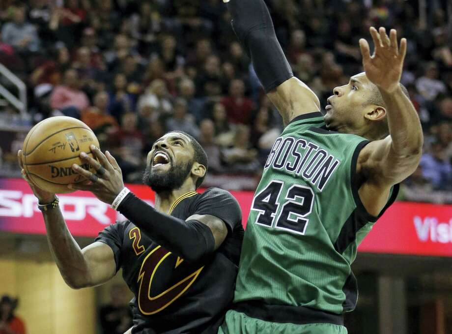 ASSOCIATED PRESS FILE PHOTO In this Dec. 29, 2016, file photo, Cleveland's Kyrie Irving, left, drives to the basket against Boston's Al Horford in the second half of an NBA regular season game. James and the defending champion Cavaliers will travel to face the top-seeded Celtics in Game 1 of the Eastern Conference finals. Photo: AP / AP 2016