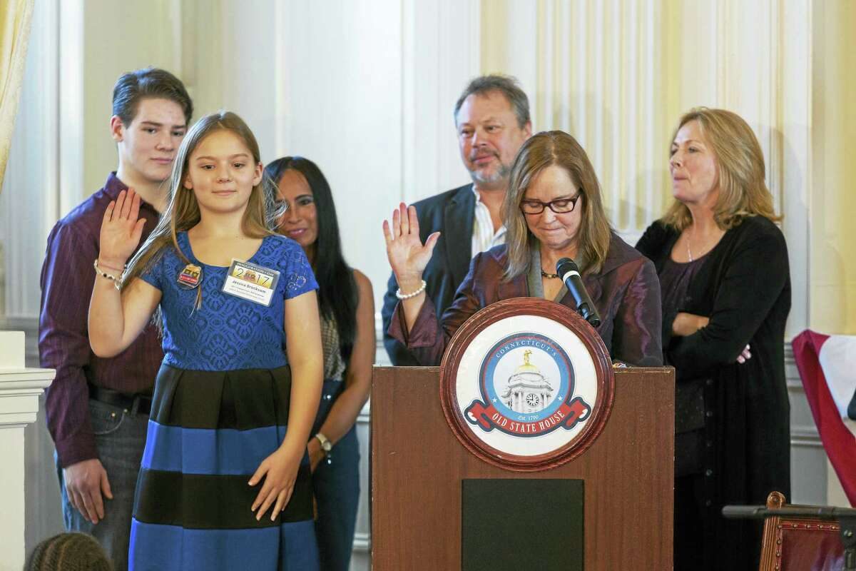 CONTRIBUTED PHOTO 2017 Connecticut's Kid Governor Jessica Brocksom, a student at John F. Kennedy School in Milford, is sworn in Jan. 13 in Hartford by Secretary of the State Denise Merrill, with Kevin Brocksom, Jessica's brother; Rose Castillo, a Brocksom family friend; Bogdan Kawejsza, Jessica's uncle; and Donna Kawejsza, Jessica's aunt.