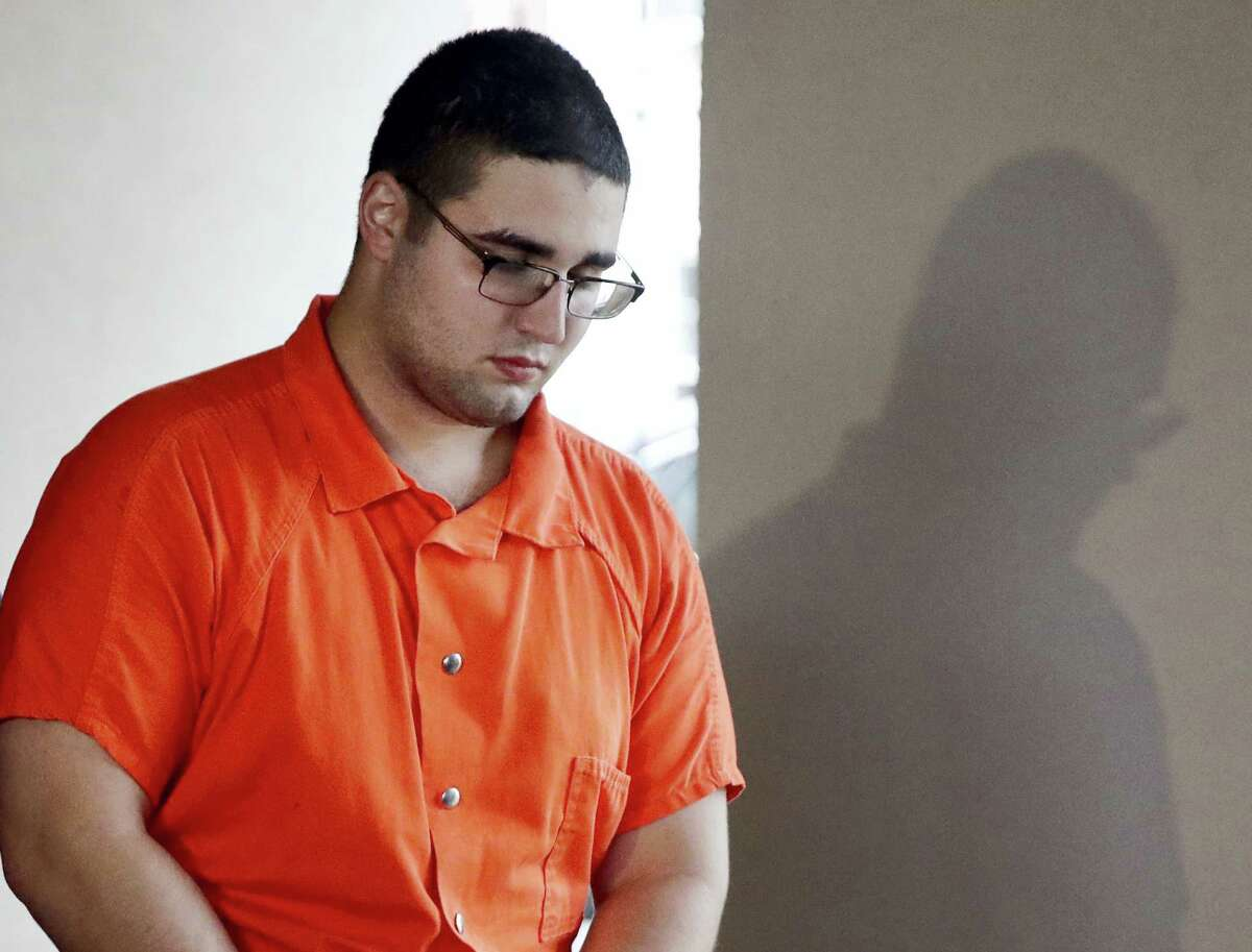 In this Thursday, July 13, 2017, photo, Cosmo DiNardo is escorted to a vehicle while in police custody in Doylestown, Pa. For DiNardo, whose lawyer said he confessed to all four killings in exchange for being spared the death penalty, brushes with the law began in his early teenage years.