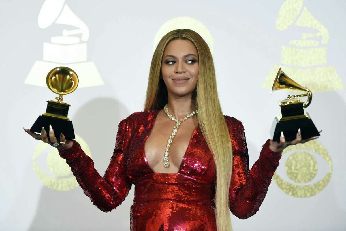 """In this Feb. 12, 2017 photo, Beyonce poses in the press room with the awards for best music video for """"Formation"""" and best urban contemporary album for """"Lemonade"""" at the 59th annual Grammy Awards at the Staples Center, in Los Angeles. Several outlets have published reports that Beyonce has given birth to twins with no official confirmation and even Beyonce's father, with whom she has had a strained relationship, tweeted congrats on June 18, 2017. But there has been no word from superstars Beyonce and Jay Z themselves."""