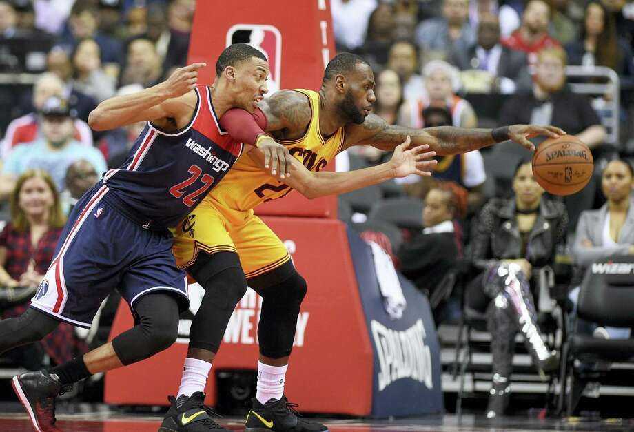 Washington Wizards forward Otto Porter Jr. (22) battles for the ball against Cleveland Cavaliers forward LeBron James (23) during the second half of an NBA basketball game on Monday, Feb. 6, 2017 in Washington. The Cavaliers won 140-135 in overtime. Photo: AP Photo/Nick Wass  / FR67404 AP
