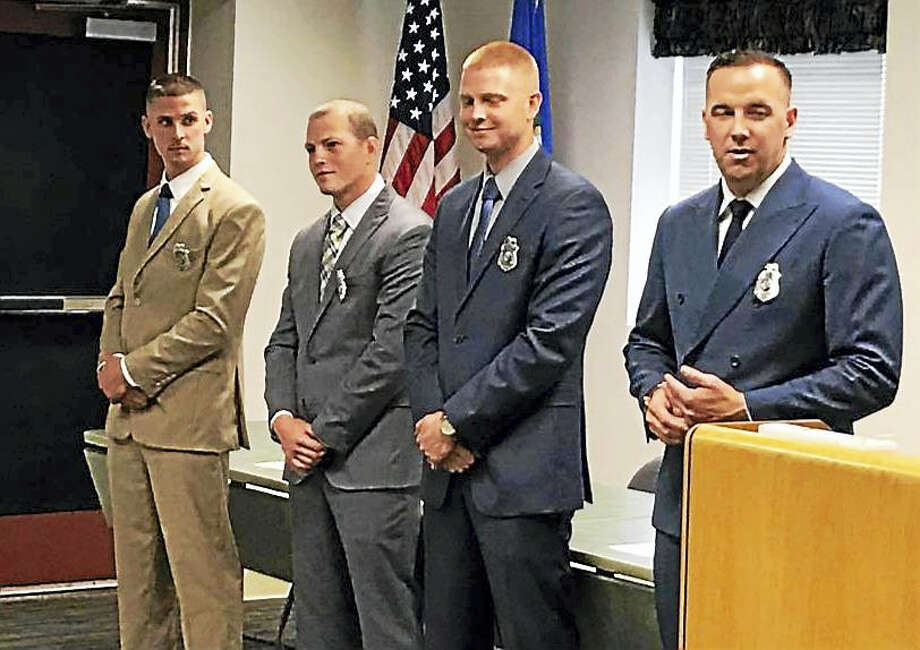 The new officers are, from left, Matthew Nettis, Michael Small, Kyle Pixley and Jared Ceccolini. Photo: Courtesy Middletown Police