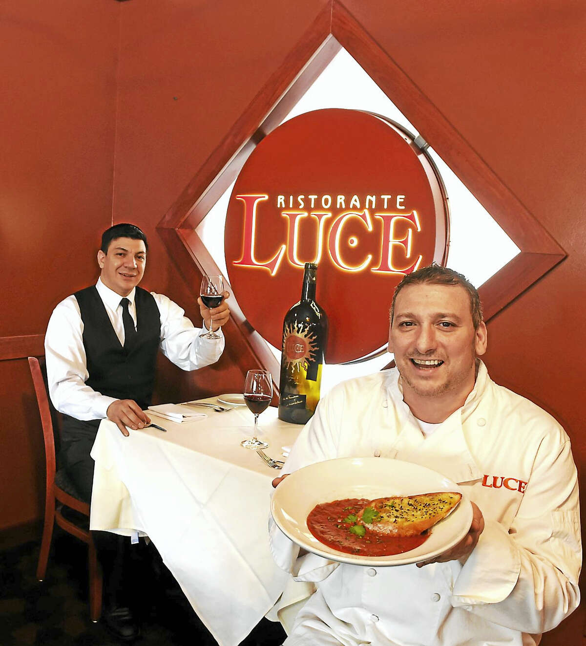 Ristorante Luce chef/owner Paul Iannaccone, right, and floor manager Edwin Picado show off their soffritto.