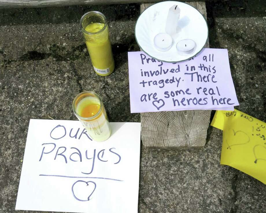 Well-wishing messages and candles for an injured employee are shown outside a grocery store in Estacada, Ore., Monday, May 15, 2017. Police say a man carrying what appeared to be a human head stabbed an employee at the grocery store. Photo: AP Photo/Gillian Flaccus   / Copyright 2017 The Associated Press. All rights reserved.