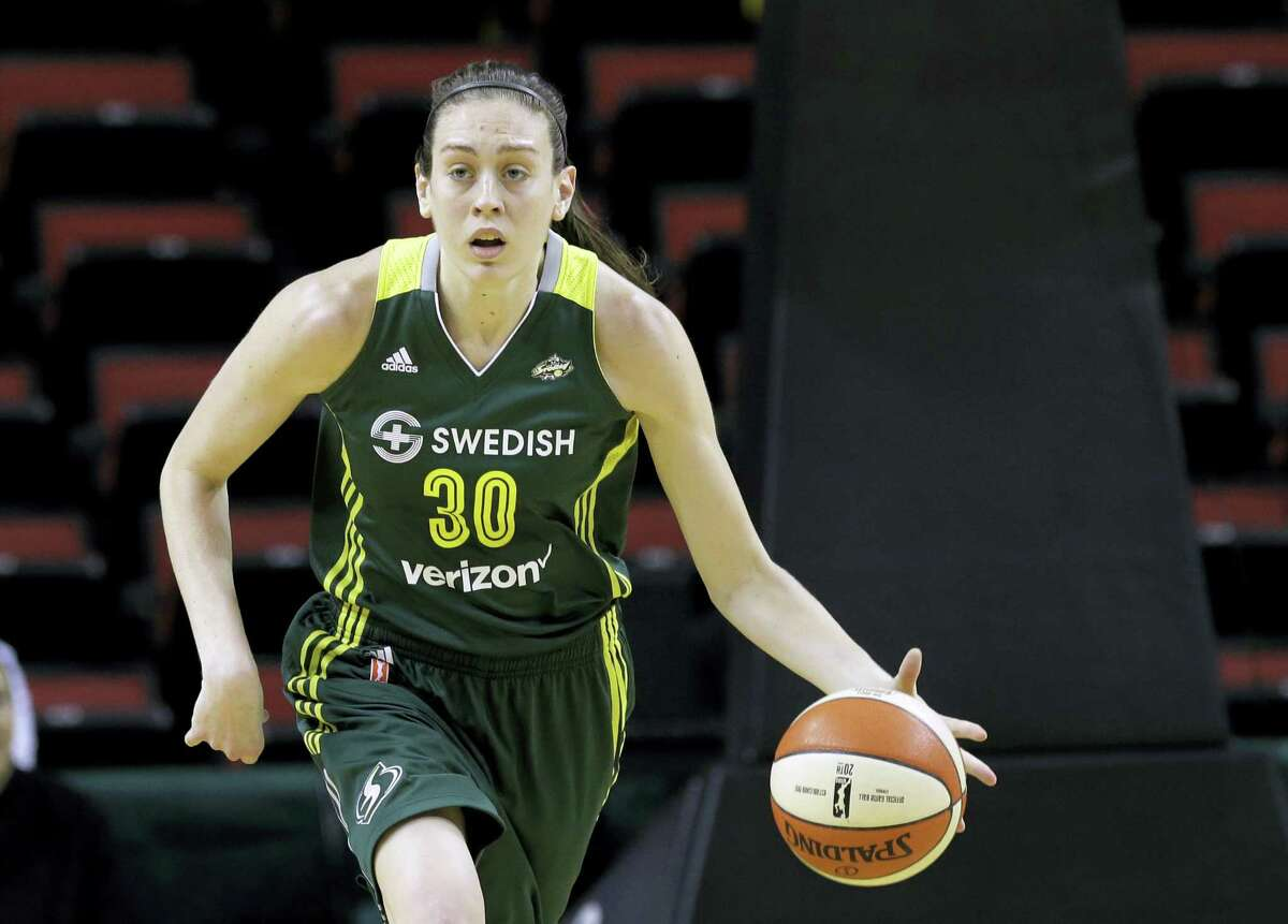 In this May 4, 2016 photo, Seattle Storm's Breanna Stewart dribbles against the Phoenix Mercury in a WNBA preseason basketball game in Seattle. Stewart will return to the U.S. from China after spraining the posterior cruciate ligament in her right knee last week while playing for Shanghai in the Chinese basketball league. The Seattle Storm star won't require surgery and is flying back Friday, Jan. 20, 2017 to rehab the injury.